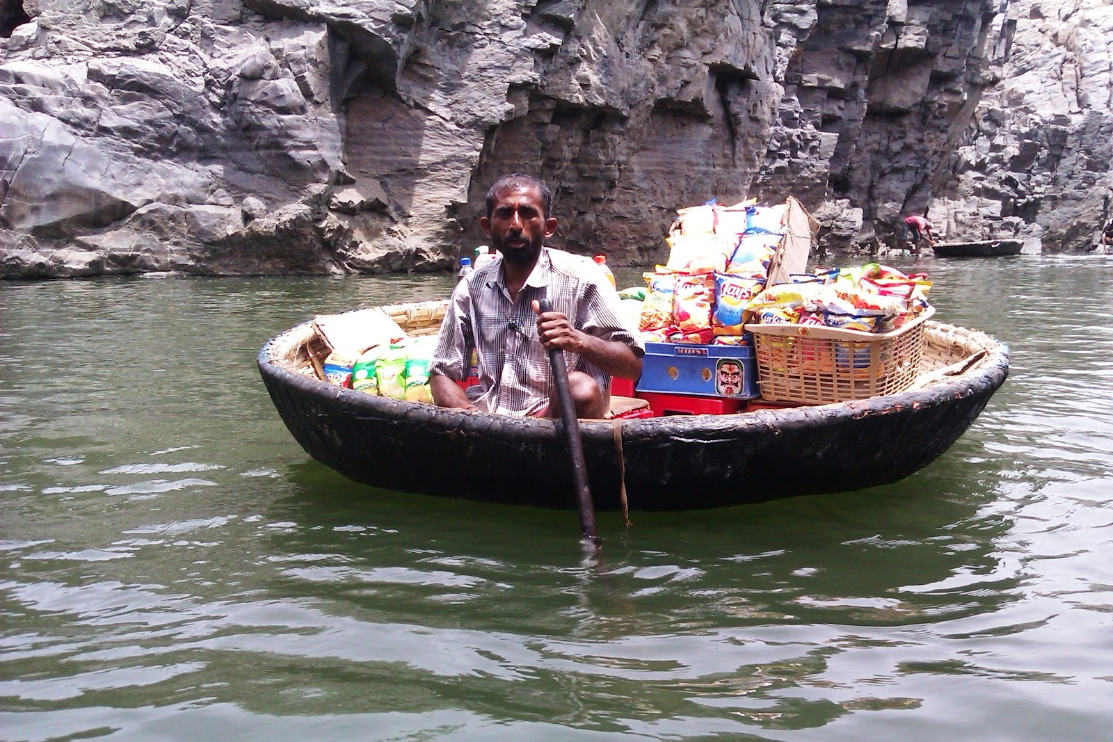 The floating stall on a Coracle in river Kaveri at Hogeynakal