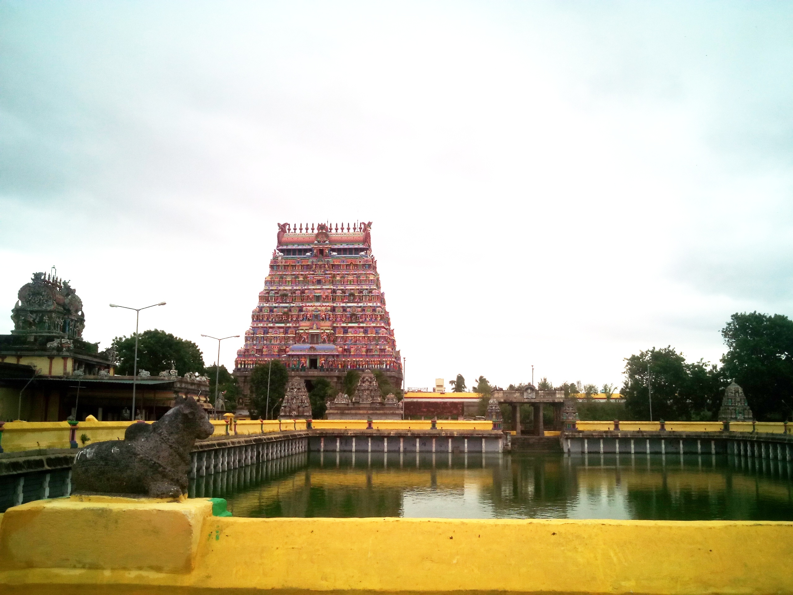 One of the temple gopurams and the holy Sivaganga tank