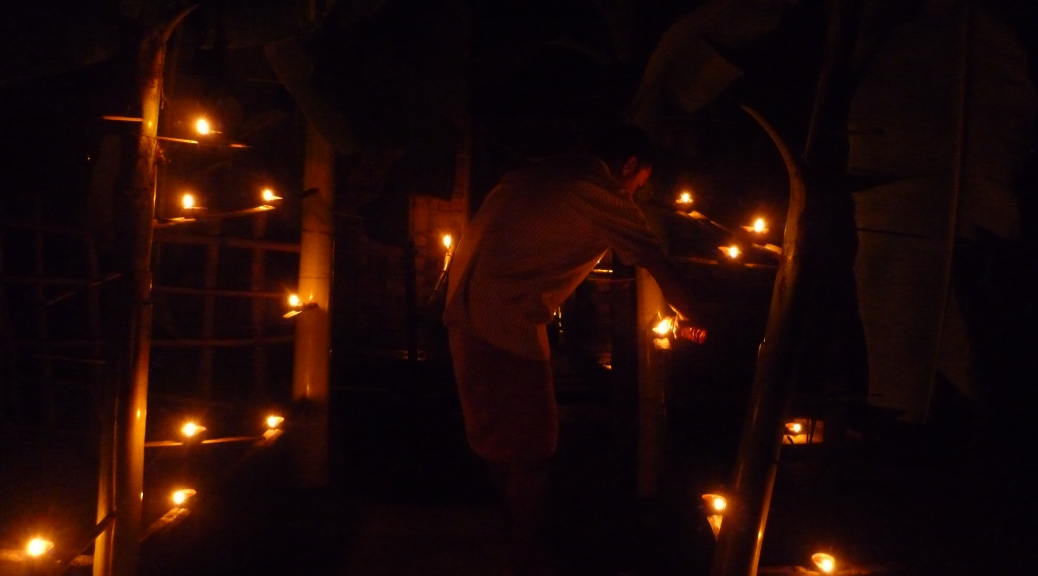 Images from Majuli island of the locals lighting up oil lit lamps in banana stems