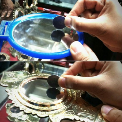 Two images that give the comparison of reflection in a glass and a metal mirror (Aranmula kannadi)