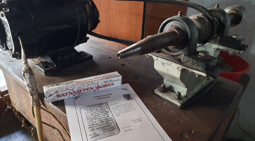 A copy of Gandhiji's letter, a fountain pen case and the lathe machine at Ratnam pens workshop